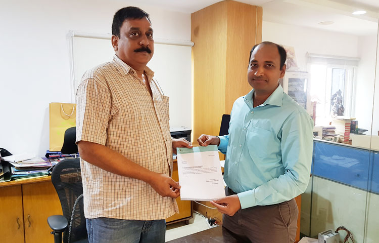 Managing Director presents an appreciation letter to Designer Ashok
